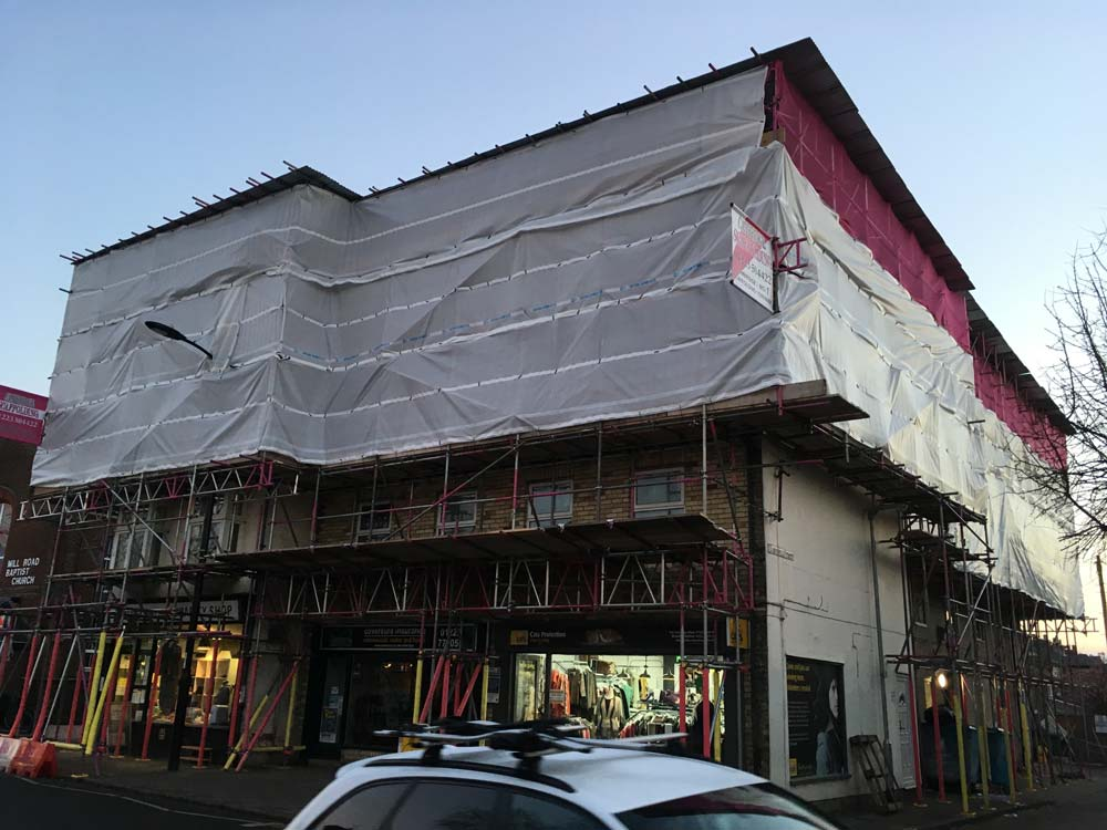 This temporary roof was put up on Mill Road in Cambridge for major loft conversion of 15 flats